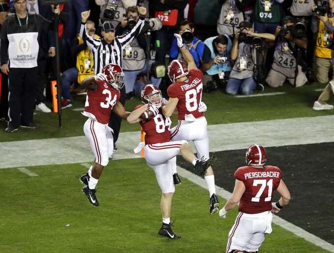 Alabama's Hale Hentges (84) celebrates his touchdown catch during the first half the NCAA college football playoff championship game against Clemson, Monday, Jan. 7, 2019, in Santa Clara, Calif. (AP Photo/Jeff Chiu)