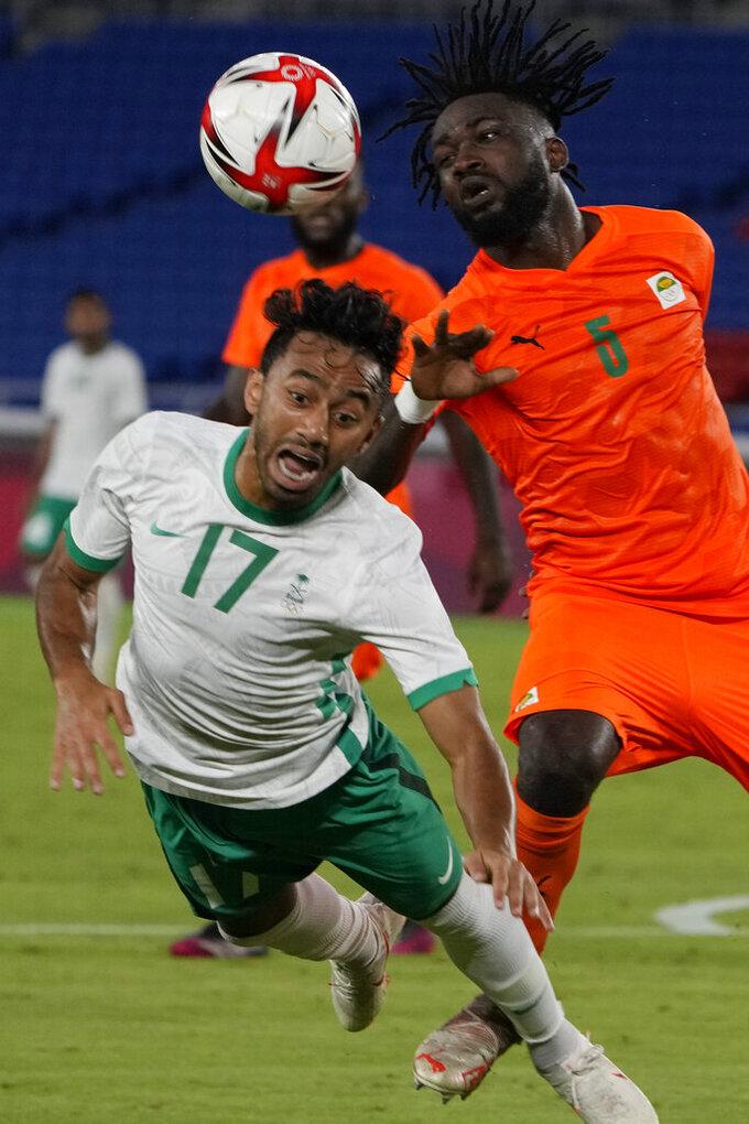 Ivory Coast's Ismael Diallo, right, and Saudi Arabia's Ayman Alkhulaif battle for the ball during a men's soccer match at the 2020 Summer Olympics, Thursday, July 22, 2021, in Yokohama, Japan. (AP Photo/Kiichiro Sato)