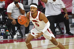 FILE - In this Feb. 16, 2021, file photo, Arkansas guard Moses Moody (5) controls the ball against Florida during the first half of an NCAA college basketball game in Fayetteville, Ark.  Moody is a member of the All-SEC first team and Newcomer of the Year in voting announced Tuesday, March 9, 2021. (AP Photo/Michael Woods, File)