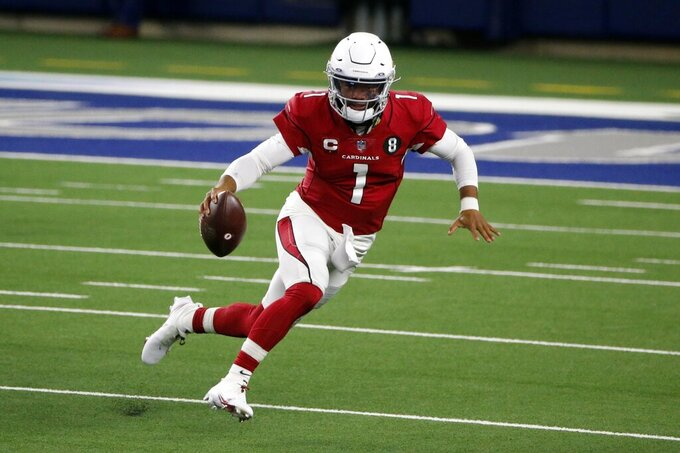 Arizona Cardinals quarterback Kyler Murray (1) carries the ball against the Dallas Cowboys in the first half of an NFL football game in Arlington, Texas, Monday, Oct. 19, 2020. (AP Photo/Michael Ainsworth)