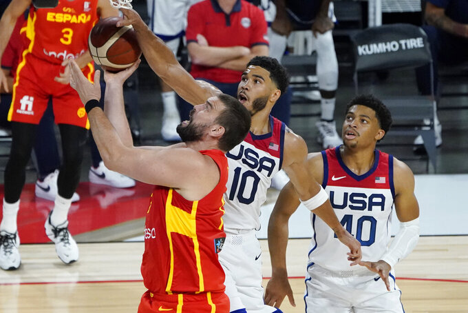 Spain's Marc Gasol (13) shoots around United States' Jayson Tatum (10) during the second half of an exhibition basketball game in preparation for the Olympics, Sunday, July 18, 2021, in Las Vegas. (AP Photo/John Locher)