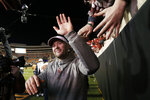 Oklahoma head coach Lincoln Riley celebrates with fans following an NCAA college football game against Oklahoma State in Stillwater, Okla., Saturday, Nov. 30, 2019. Oklahoma won 34-16. (AP Photo/Sue Ogrocki)