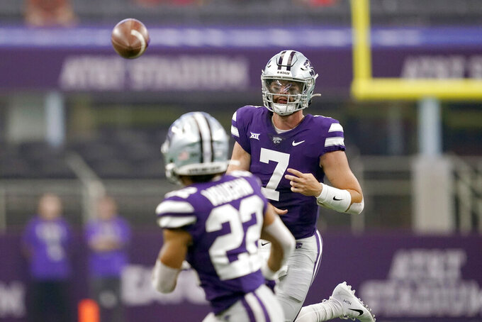 Kansas State quarterback Skylar Thompson (7) throws a pass to running back Deuce Vaughn (22) in the first half of an NCAA college football game against Stanford in Arlington, Texas, Saturday, Sept. 4, 2021. (AP Photo/Tony Gutierrez)