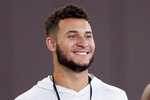FILE - Caleb Farley smiles during Virginia Tech NFL football pro day in Blacksburg, Va., in this Friday, March 26, 2021, file photo. Farley is a possible first round pick in the NFL Draft, April 19-May 1, 2021, in Cleveland. (AP Photo/Matt Gentry, File)