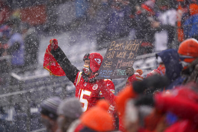 A Kansas City Chiefs fan looks on during the first half of an NFL football game against the Denver Broncos, Sunday, Oct. 25, 2020, in Denver. (AP Photo/David Zalubowski)