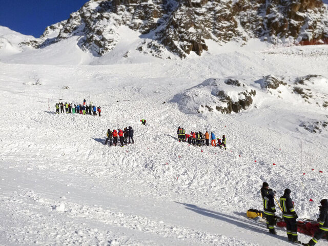 Rescuers at work following an avalanche in Val Senales, Saturday, Dec. 28, 2019. An avalanche has killed a woman and a two children who were skiing on a glacier in the Italian Alps. An Alpine rescue corps spokesman says helicopters are searching for any other possible victims of Saturday's avalanche. (ANSA via AP)