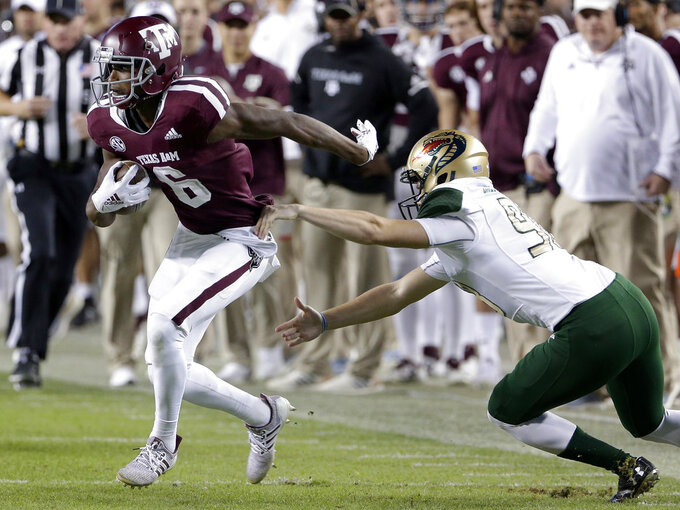 Texas A&M wide receiver Roshauud Paul (6) breaks the tackle attempt by UAB defensive lineman Tyrus Butler, right, during the first half of an NCAA college football game Saturday, Nov. 17, 2018, in College Station, Texas. (AP Photo/Michael Wyke)