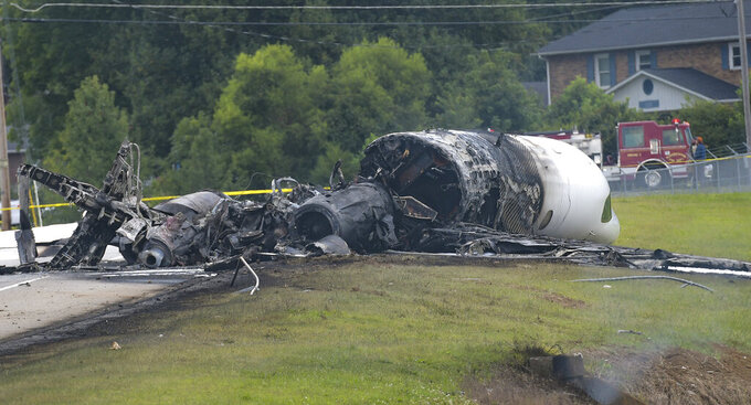 "The burned remains of a plane that was carrying NASCAR television analyst and former driver Dale Earnhardt Jr. lie near a runway Thursday, Aug. 15, 2019, in Elizabethton, Tenn. Officials said the Cessna Citation rolled off the end of a runway and caught fire after landing at Elizabethton Municipal Airport. Earnhardt's sister, Kelley Earnhardt Miller, tweeted that ""everyone is safe and has been taken to the hospital for further evaluation."" (Earl Neikirk/Bristol Herald Courier via AP)"