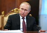Russian President Vladimir Putin chairs a meeting on preventing the spread of coronavirus in Moscow, Russia, Wednesday, Jan. 29, 2020.  Putin has urged the country's government to