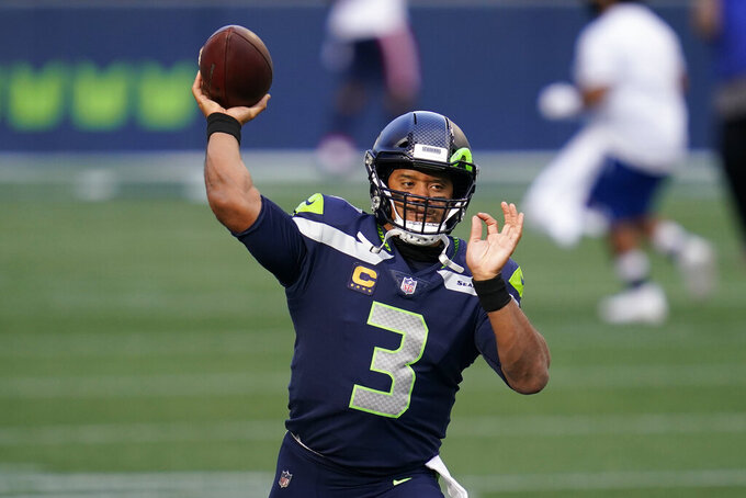 Seattle Seahawks quarterback Russell Wilson passes during warmups before an NFL football game against the New England Patriots, Sunday, Sept. 20, 2020, in Seattle. (AP Photo/Elaine Thompson)