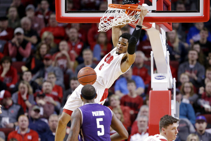 Nebraska's James Palmer Jr. (0) dunks as Northwestern's Dererk Pardon (5) watches during the second half of an NCAA college basketball game in Lincoln, Neb., Saturday, Feb. 16, 2019. (AP Photo/Nati Harnik)