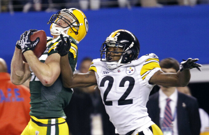 FILE - In this Feb. 6, 2011, file photo, Green Bay Packers' Jordy Nelson, left, catches a touchdown pass in front of Pittsburgh Steelers' William Gay (22) during the first quarter of the NFL football Super Bowl XLV game, in Arlington, Texas. Nelson signed a one-day contract with the Packers on Tuesday, Aug. 6, 2019, and announced his retirement after 11 seasons, 10 of which he spent in Green Bay. (AP Photo/Eric Gay, File)