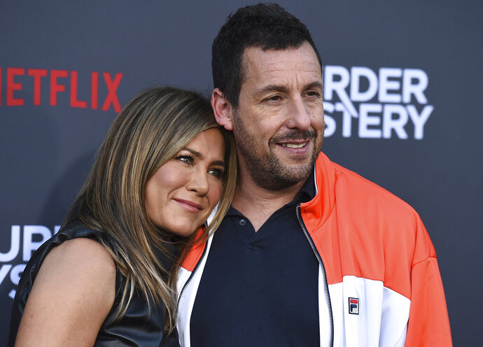 Cast members Jennifer Aniston and Adam Sandler arrive at the Los Angeles premiere of