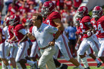 """FILE - In this Sept. 28. 2019, file photo, Alabama coach Nick Saban leads the team onto the field before an NCAA college football game against Mississippi in Tuscaloosa, Ala. The Alabama football team released an emotional video Thursday, June 25, 2020, speaking out against racism and ending with the message that """"all lives can't matter until Black lives matter."""" Saban and many prominent players, both Black and white, appear in the video that was written by Alabama left tackle Alex Leatherwood. (AP Photo/Vasha Hunt, File)"""
