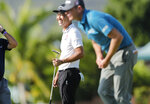 Kevin Na, center, smiles on the 18th green after the final round of the Sony Open golf tournament Sunday, Jan. 17, 2021, at Waialae Country Club in Honolulu. (Jamm Aquino/Honolulu Star-Advertiser via AP)
