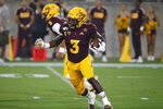 Arizona State running back Eno Benjamin runs with the ball during the first half of the team's NCAA college football game against Kent State on Thursday, Aug. 29, 2019, in Tempe, Ariz. (AP Photo/Ralph Freso)
