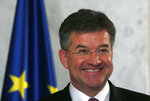 European Union envoy for the negotiations Miroslav Lajcak smiles during a press conference after talks with Serbian President Aleksandar Vucic in Belgrade, Serbia, Monday, June 22, 2020. Europe and the United States are coordinating efforts toward urging Serbia and Kosovo to reach a deal. (AP Photo/Darko Vojinovic)