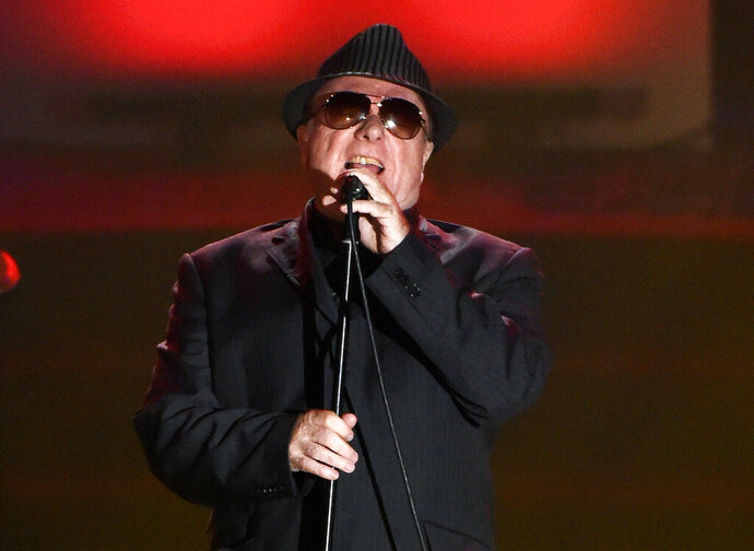 """FILE - In this June 18, 2015 file photo, Van Morrison performs at the 46th annual Songwriters Hall of Fame Induction and Awards Gala in New York. Van Morrison is to release three new songs over the coming weeks that take a swipe at the lockdown restrictions imposed by the British government. In 'No More Lockdown,' the Northern Irishman says the curbs """"enslave"""" people, effectively labels the government as """"fascist bullies,"""" condemns celebrities for """"telling us what we are supposed to feel"""" and charges scientists for """"making up crooked facts."""" (Photo by Evan Agostini/Invision/AP, File)"""
