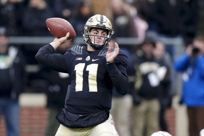 Purdue quarterback David Blough (11) throws against Wisconsin during the first half of an NCAA college football game in West Lafayette, Ind., Saturday, Nov. 17, 2018. (AP Photo/Michael Conroy)
