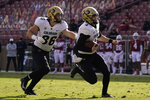 Colorado quarterback Sam Noyer, right, runs toward the end zone in front of tight end C.J. Schmanski to score a touchdown against Stanford during the first half of an NCAA college football game in Stanford, Calif., Saturday, Nov. 14, 2020. (AP Photo/Jeff Chiu)