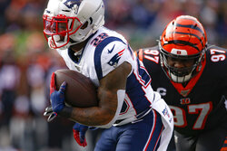 New England Patriots running back James White (28) runs the ball for a touchdown past Cincinnati Bengals defensive tackle Geno Atkins (97) in the first half of an NFL football game, Sunday, Dec. 15, 2019, in Cincinnati. (AP Photo/Gary Landers)