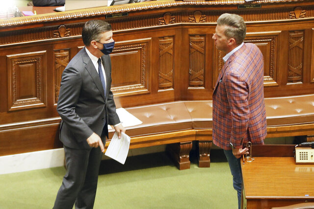 Democrat House Majority Leader Ryan Winkler, left, talks with Minority Leader Kurt Daudt as the Minnesota Legislature meets Monday, July 13, 2020 for a second special session in St. Paul, Minn. (AP Photo/Jim Mone)