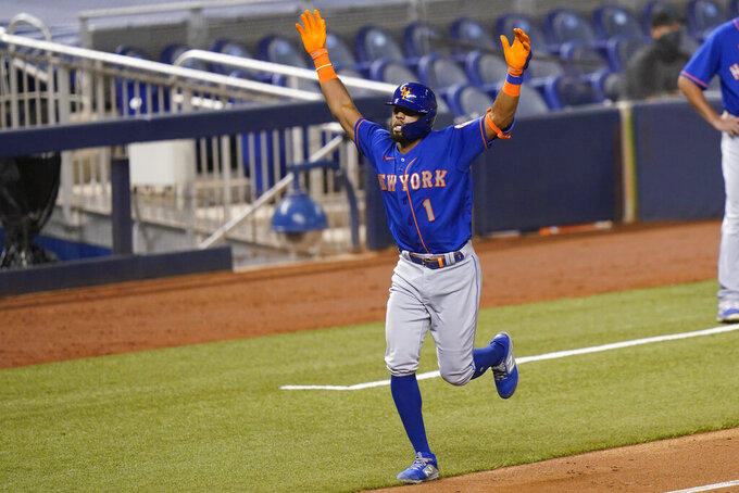 New York Mets' Amed Rosario (1) reacts as he runs the bases after hitting a solo home during the seventh inning of a baseball game against the Miami Marlins, Tuesday, Aug. 18, 2020, in Miami. (AP Photo/Lynne Sladky)
