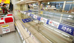 Shelves are empty at a supermarket in Tateyama, Chiba prefecture, near Tokyo as Typhoon Hagibis approaches Friday, Oct. 11, 2019. A powerful typhoon is forecast to bring up to 80 centimeters (31 inches) of rain and damaging winds to the Tokyo area and Japan's Pacific coast this weekend, and the government is warning residents to stockpile necessities and leave high-risk places before it's too dangerous. (Naoya Osato/Kyodo News via AP)