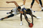 Colorado's Jeriah Horne, left, and California's Kuany Kuany scramble for the ball during the first half of an NCAA college basketball game in the quarterfinal round of the Pac-12 men's tournament Thursday, March 11, 2021, in Las Vegas. (AP Photo/John Locher)