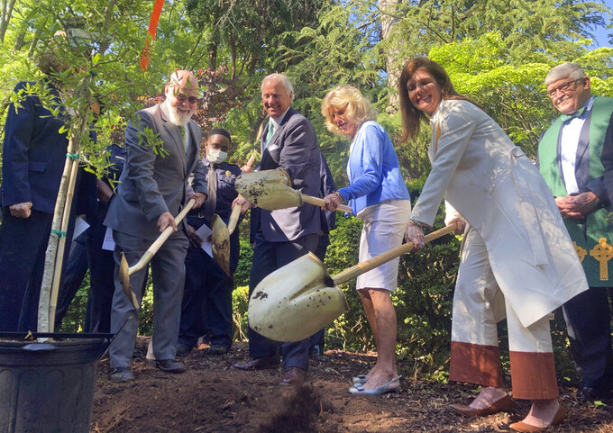 From left, South Carolina Floodwater Commission Chairman Tom Mullikin, Gov. Henry McMaster, First Lady Peggy McMaster and Lt. Gov. Pamela Evette plant loblolly pine seeds on the grounds of the Governor's Mansion in Columbia, S.C., Thursday, April 22, 2021. Officials gathered to commemorate the planting of more than three million tree seeds across the state on Earth Day this year. (AP Photo/Michelle Liu)