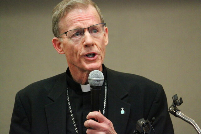 FILE - In this Nov. 29, 2018, file photo, Archbishop John C. Wester, head of the Archdiocese of Santa Fe, talks during a news conference in Santa Fe. New Mexico's largest Catholic diocese has filed a complaint against the U.S. Small Business Administration. The Archdiocese of Santa Fe claims the agency is illegally blocking it from applying for federal aid meant to help businesses affected by the coronavirus outbreak. (AP Photo/Susan Montoya Bryan, File)