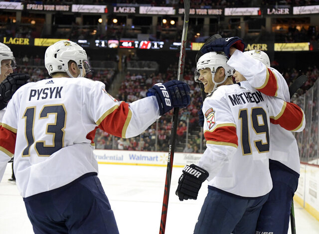 Florida Panthers defenseman Mike Matheson (19) celebrates his goal with defenseman Mark Pysyk (13) during the first period of an NHL hockey game against the New Jersey Devils Tuesday, Feb. 11, 2020, in Newark, N.J. (AP Photo/Bill Kostroun)