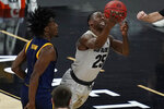 Colorado's McKinley Wright IV (25) shoots around California's Joel Brown (1) during the first half of an NCAA college basketball game in the quarterfinal round of the Pac-12 men's tournament Thursday, March 11, 2021, in Las Vegas. (AP Photo/John Locher)