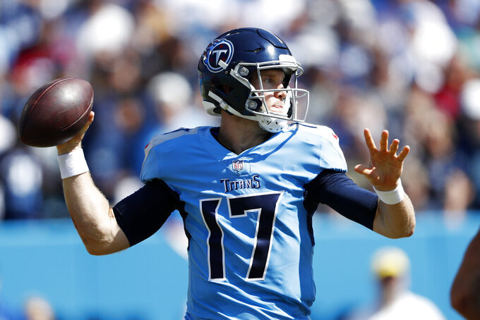 Tennessee Titans quarterback Ryan Tannehill passes against the Indianapolis Colts in the first half of an NFL football game Sunday, Sept. 26, 2021, in Nashville, Tenn. (AP Photo/Wade Payne)