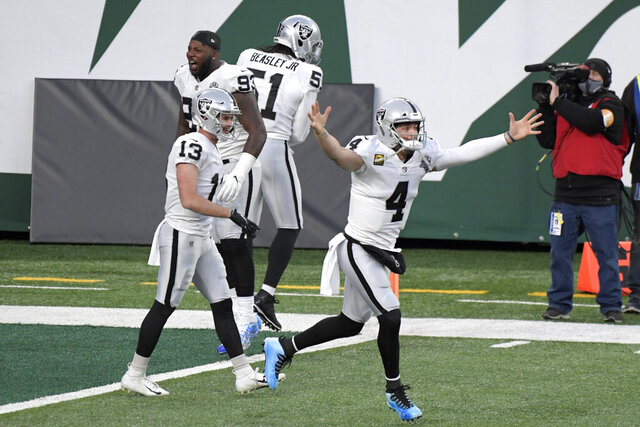 Las Vegas Raiders quarterback Derek Carr, right, celebrates his touchdown pass to Henry Ruggs III during the second half an NFL football game against the New York Jets, Sunday, Dec. 6, 2020, in East Rutherford, N.J. (AP Photo/Bill Kostroun)