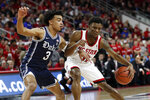 Duke guard Tre Jones (3) guards North Carolina State guard Markell Johnson (11) during the first half of an NCAA college basketball game in Raleigh, N.C., Wednesday, Feb. 19, 2020. (AP Photo/Gerry Broome)