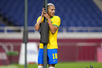 Brazil's Richarlison reacts after missing chance to score during a men's quarterfinal soccer match against Egypt at the 2020 Summer Olympics, Saturday, July 31, 2021, in Saitama, Japan. (AP Photo/Martin Mejia)