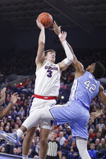Gonzaga forward Filip Petrusev (3) shoots over North Carolina forward Brandon Huffman (42) during the first half of an NCAA college basketball game in Spokane, Wash., Wednesday, Dec. 18, 2019. (AP Photo/Young Kwak)