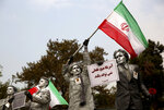 FILE - In this Nov. 4, 2013, file photo, Iranian artists hold posters in Farsi reading,