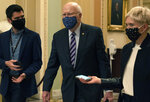 Sen. Patrick Leahy, D-Vt., center, walks with reporters, Tuesday, Jan. 26, 2021, as he leaves the Senate floor on Capitol Hill in Washington. (AP Photo/Jacquelyn Martin)