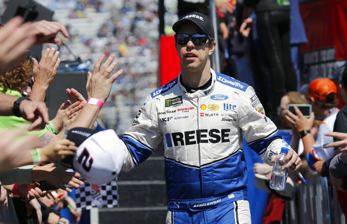 NASCAR Cup Series driver Brad Keselowski greets fans during driver introductions prior to the NASCAR Cup Series auto race at the Martinsville Speedway in Martinsville, Va., Sunday, March 24, 2019. (AP Photo/Steve Helber)
