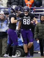 Northwestern wide receiver Bennett Skowronek, right, celebrates with wide receiver Riley Lees after catching a touchdown pass during the first half of an NCAA college football game against Illinois in Evanston, Ill., Saturday, Nov. 24, 2018. (AP Photo/Nam Y. Huh)
