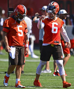 Cleveland Browns quarterback Baker Mayfield (6) talks with Case Keenum in between drills during an NFL football practice in Berea, Ohio, Tuesday, Aug. 24, 2021. (AP Photo/David Dermer)