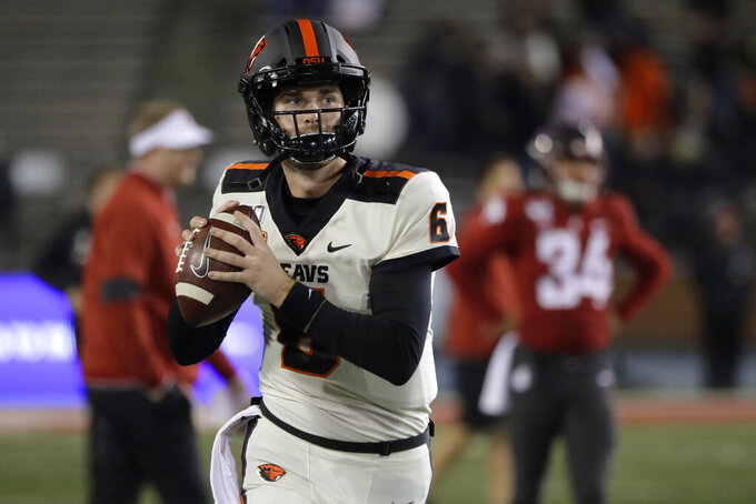 Oregon State quarterback Jake Luton warms up for the team's NCAA college football game against Washington State on Saturday, Nov. 23, 2019, in Pullman, Wash. (AP Photo/Ted S. Warren)