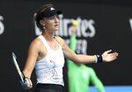 France's Kristina Mladenovic opens her arms after a shot to United States' Jessica Pegula during their match at the Australian Open tennis championships in Melbourne, Australia, Saturday, Feb. 13, 2021. (AP Photo/Hamish Blair)
