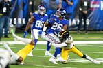 New York Giants running back Saquon Barkley (26) tries to avoid a tackle by Pittsburgh Steelers cornerback Joe Haden (23) during the third quarter of an NFL football game Monday, Sept. 14, 2020, in East Rutherford, N.J. (AP Photo/Frank Franklin II)