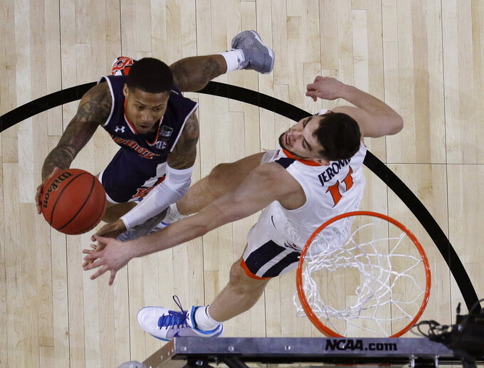 Auburn guard J'Von McCormick, left, drives to the basket over Virginia guard Ty Jerome during the first half in the semifinals of the Final Four NCAA college basketball tournament, Saturday, April 6, 2019, in Minneapolis. (AP Photo/David J. Phillip)