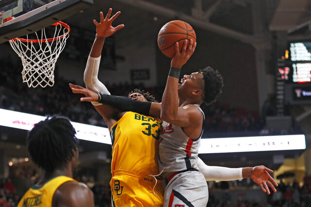 Texas Tech's Terrence Shannon Jr. (1) tries to shoot over Baylor's Freddie Gillespie (33) during the first half of an NCAA college basketball game Tuesday, Jan. 7, 2020, in Lubbock, Texas. (AP Photo/Brad Tollefson)