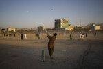 Afghans play cricket at the Chaman-e-Hozari Park in Kabul, Afghanistan, Friday, Sept. 17, 2021. (AP Photo/Bernat Armangue)