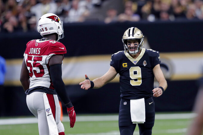 New Orleans Saints quarterback Drew Brees (9) reacts towards Arizona Cardinals linebacker Chandler Jones (55) between plays in the first half of an NFL football game in New Orleans, Sunday, Oct. 27, 2019. (AP Photo/Bill Feig)
